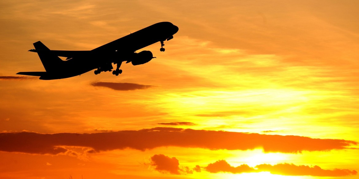 File photo dated 21/04/10 of a plane leaving Newcastle Airport as the controversy over holiday companies charging extra during school holidays will be debated today after an e-petition received almost 170,000 signatures.
